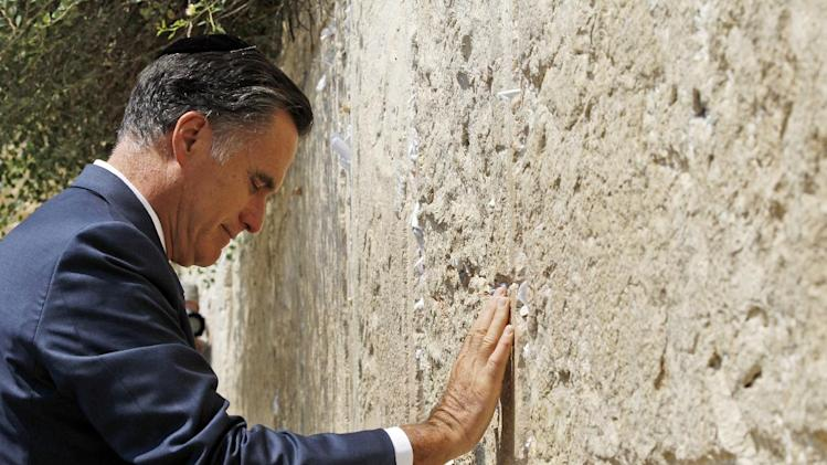 Republican presidential candidate and former Massachusetts Gov. Mitt Romney pauses as he visits the Western Wall in Jerusalem, Sunday, July 29, 2012. (AP Photo/Charles Dharapak)