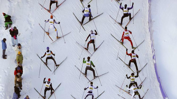An aerial view shows cross-country skiers climbing a hill during the 46th Engadin Ski Marathon near the Swiss mountain resort of St. Moritz