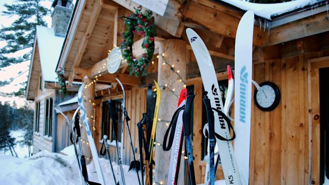 This December 2012 photo shows cross-country skis left by guests outside the Appalachian Mountain Club's Gorman Chairback Lodge, a backcountry wilderness lodge near Greenville, Maine. In winter, visitors can reach the lodges and cabins only by cross-country skiing in.  (AP Photo/Lynn Dombek)