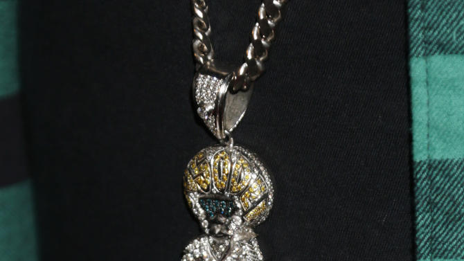 Jermaine Dupri's necklace at a Celebration of LA's Music Industry at the Getty House on Thursday, Feb. 7, 2013 in Los Angeles. (Photo by Todd Williamson/Invision/AP)