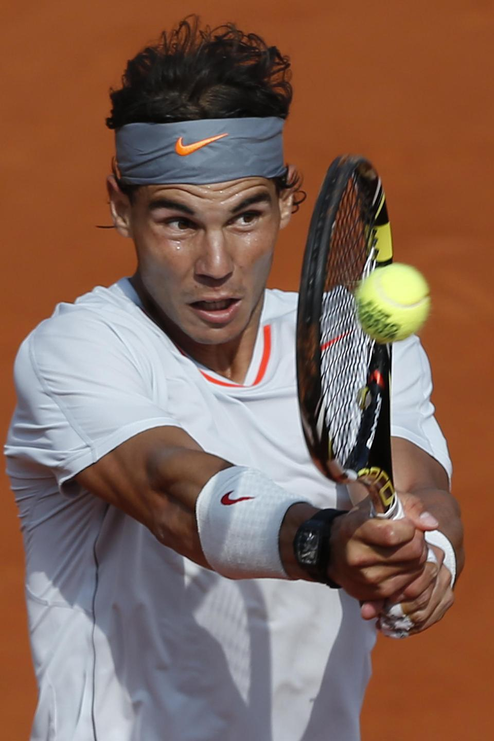 Spain's Rafael Nadal returns against Switzerland's Stanislas Wawrinka in their quarterfinal match at the French Open tennis tournament, at Roland Garros stadium in Paris, Wednesday June 5, 2013. (AP Photo/Petr David Josek)