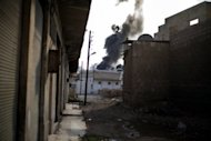 Smoke billows from a site bombed by the Syrian Air Force in the rebel-controlled town of Al-Bab, 35 kilometers northeast of Aleppo. Fighting raged in Syria's two biggest cities on Sunday as UN-Arab League envoy Lakhdar Brahimi ended his first visit to the country on a peace mission a rebel commander said was doomed to fail