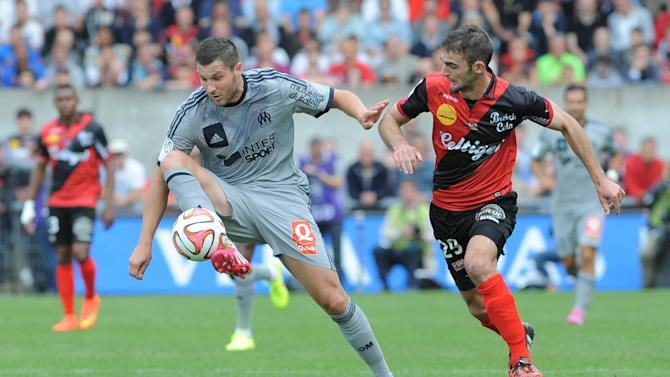 Guingamp's French defender Christophe Kerbrat (R) vies with Marseille's French forward Andre-Pierre Gignac during the French L1 football match Guingamp vs Marseille on August 23, 2014 at the Roudourou stadium in Guingamp