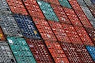 Containers wait to be loaded on a ship at the harbour in the northern German city of Hamburg. China was the top foreign investor in Germany in 2011, ahead of the United States, Switzerland and France, the government development agency Germany Trade & Invest said on Thursday