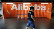 <p>A Chinese Alibaba employee walks through a communal space at the company headquarters in Hangzhou in June 2012. Chinese e-commerce giant Alibaba announced that it has bought back billions of dollars worth of stock from Yahoo! in a step toward independence from the US Internet pioneer.</p>