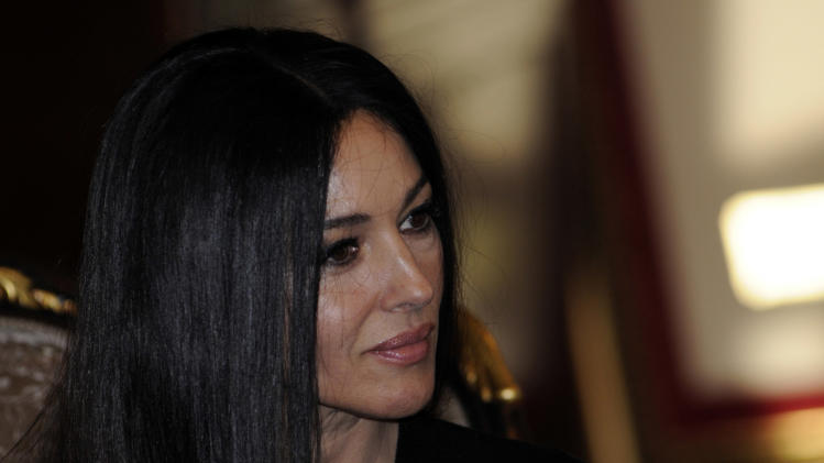 Italian actress Monica Bellucci talks with the President of Republic of Srpska Milorad Dodik , during a visit to Bosnian town of Banja Luka, 240 kms northwest of Sarajevo, Bosnia, on Saturday, Jan. 19, 2013. (AP Photo/Radivoje Pavicic )