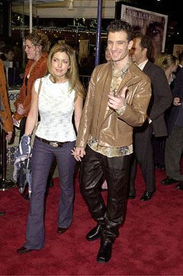 JC Chasez of N Sync with a girl who probably can't walk down the street without being attacked and beaten by psychotic thirteen-year-old girls at the Westwood premiere of 20th Century Fox's Cast Away