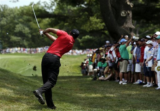 Tiger Woods takes another step toward the top
