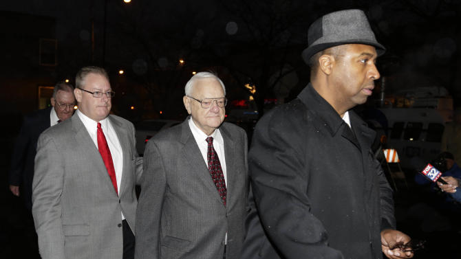 Former Illinois Gov. George Ryan, center, arrives at a halfway house in Chicago Wednesday, Jan. 30, 2013, after serving five-plus years in federal prison on corruption charges. The 78-year-old Ryan began serving his 6 1/2-year sentence in November 2007 in Oxford, Wis., and was released from another prison in Terra Haute, Ind., to enter the halfway house under a work-release program. (AP Photo/M. Spencer Green)