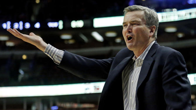 Northwestern head coach Bill Carmody reacts during the second half of an NCAA college basketball game at the Big Ten tournament against Iowa Thursday, March 14, 2013, in Chicago. (AP Photo/Charles Rex Arbogast)