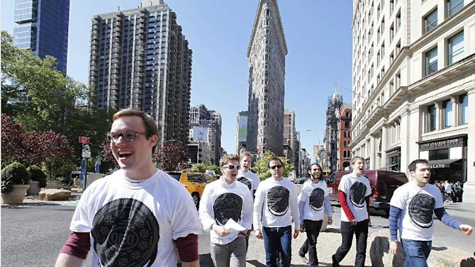 IMAGE DISTRIBUTED FOR OREO - A cappella singers took to the streets of New York, Tuesday, May 14, 2013, to launch the new OREO Wonderfilled campaign, performing the brand's new song and sharing OREO cookies.  (Photo by Amy Sussman/Invision for OREO/AP Images)