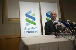 Standard Chartered Group Chief Executive Sands speaks during a news conference in Hong Kong