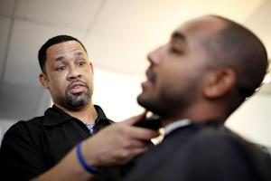 Dorsey Jackson trims Be-Emnet Zegeye's beard at his …