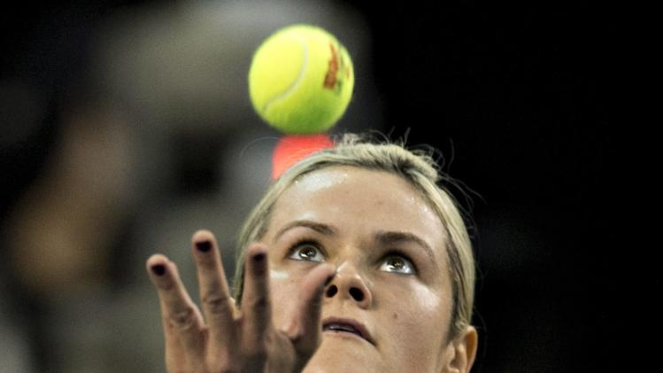 Alexandra Wozniak, of Canada, serves a shot to Jana Cepelova, of Slovakia, during the first match at the Fed Cup tennis tournament Saturday, April 19, 2014, at Laval University in Quebec City. (AP Photo/The Canadian Press, Jacques Boissinot)