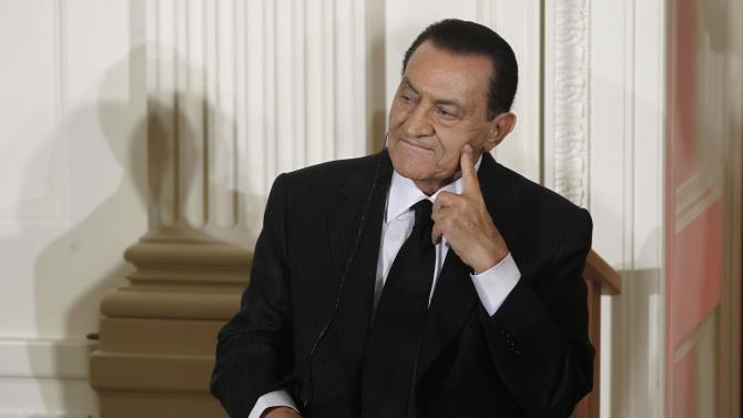 """FILE - In this Wednesday, Sept. 1, 2010 file photo, Egypt's then President Hosni Mubarak listens as Israel's Prime Minister Benjamin Nethanyahu, unseen, speaks in the East Room of the White House in Washington. Ousted Egyptian President Hosni Mubarak may have cancer, his defense lawyer said Monday,  June 20, 2011 citing """"evidence suggesting"""" the 83-year-old is sick with stomach cancer. (AP Photo/Charles Dharapak, File)"""