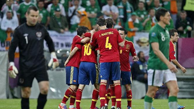Spanish players celebrate their fourth goal during the Euro 2012 soccer championship Group C match between Spain and Ireland in Gdansk, Poland, Thursday, June 14, 2012. (AP Photo/Michael Sohn)