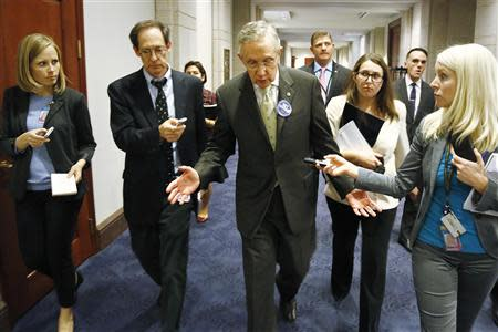 Reid departs rally celebrating Obamacare at the U.S. Capitol in Washington