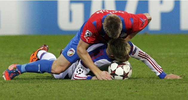 CSKA Moscow's Keisuke Honda collides with Viktoria Plzen's Vaclav Prochazka during their Champions League soccer match in Plzen