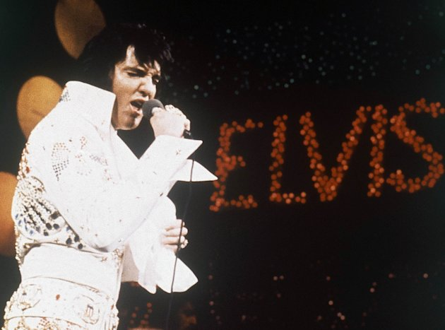 "FILE - This 1972 file photo shows Elvis Presley, the King of Rock ""n"" Roll, during a performance. The former Beverly Hills home of the late Elvis Presley and his wife Priscilla is up for sale for a cool $12.9 million. Real estate website operator Trulia says the home hit the market Wednesday, Oct. 10, 2012. (AP Photo, file)"