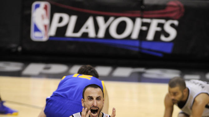 San Antonio Spurs' Manu Ginobili, of Argentina, reacts after fouling Golden State Warriors' Andrew Bogut, left rear, as Spurs' Tony Parker, right, of France, grabs the ball during the second half of Game 1 of the Western Conference semifinal NBA basketball playoff series, Monday, May 6, 2013, in San Antonio. San Antonio won 129-127 in double overtime. (AP Photo/Darren Abate)