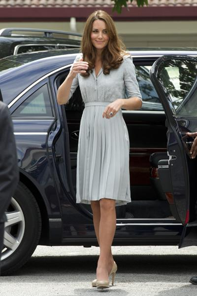 Is it just us or is this Jenny Packham dress a bit too cute for Kate? The pleated skirt and embroidered button-up mini-cardigan needs a bit more oomph; something more adult. Or maybe we're just bored