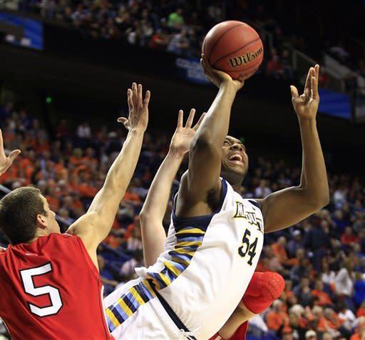 Marquette escapes Davidson, 59-58, in NCAA tourney