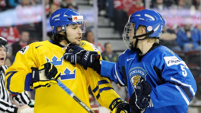 Rasmus Ristolainen #5 Of Team Finland And Ludvig Rensfeldt #23 Of Team Sweden Exchange Words Getty Images