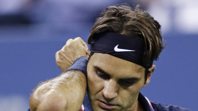 Roger Federer, of Switzerland, wipes his face during a quarterfinals match againstTomas Berdych, of Czech Republic, at the U.S. Open tennis tournament, Wednesday, Sept. 5, 2012, in New York. (AP Photo/Darron Cummings)