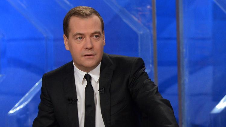 Russian Prime Minister Dmitry Medvedev speaks during a live televised interview from Moscow's Ostankino TV Center in Moscow, Russia, Friday, Dec. 6, 2013. (AP Photo/RIA-Novosti, Alexander Astafyev, Government Press Service)