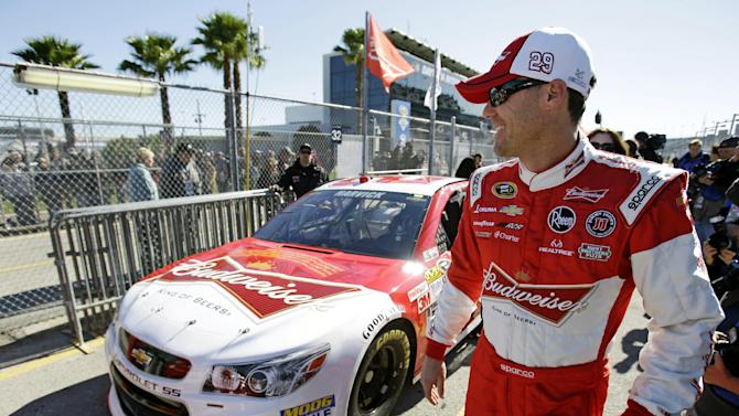 Kevin Harvick walks by his car on pit road after qualifying for the NASCAR Daytona 500 Sprint Cup Series auto race at Daytona International Speedway, Sunday, Feb. 17, 2013, in Daytona Beach, Fla. (AP Photo/John Raoux)