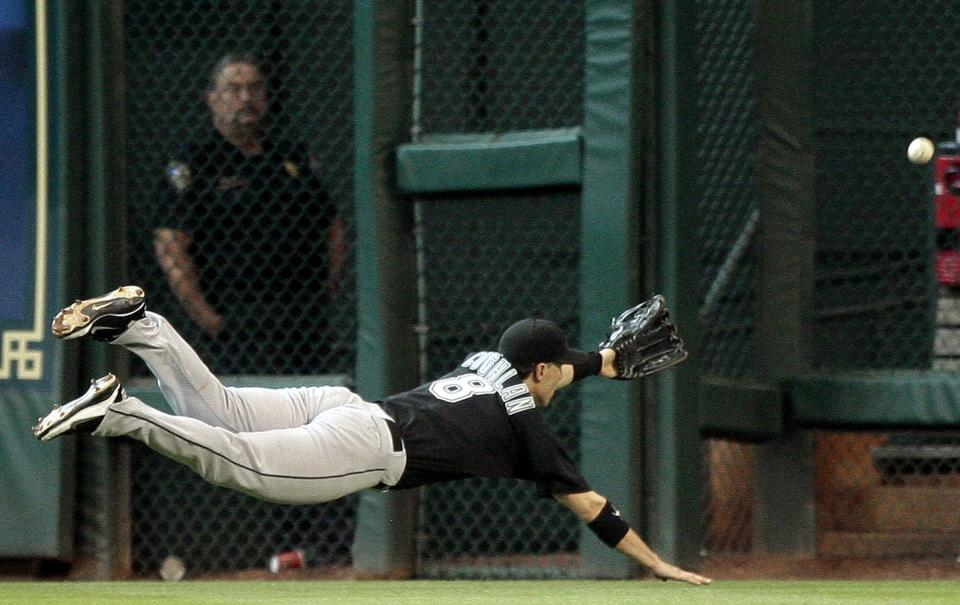 Florida Marlins' Chris Coghlan (8) makes a diving attempt on a ball hit to right centerfield by Houston Astros' Bill Hall in the fifth inning of an MLB baseball game on Sunday, April 10, 2011, in Houston. Houston won 7-1. (AP Photo/Bob Levey)