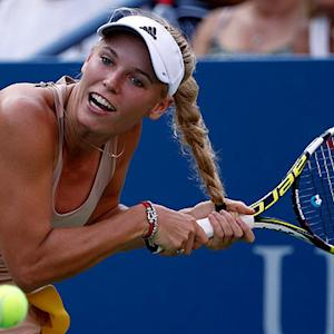 Caroline Wozniacki gets her hair tangled in her racquet during U.S. Open victory