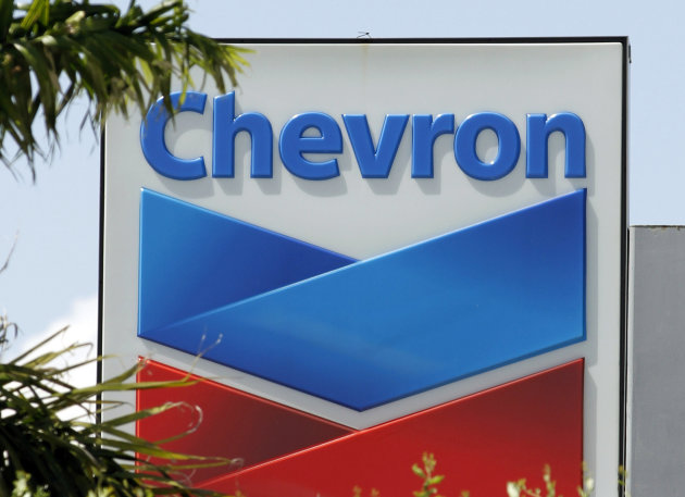 This Monday, Aug. 20, 2012 photo shows a Chevron sign in Miami. Chevron Corp. said Friday, Nov. 2, 2012, its third-quarter net income fell 33 percent as production declined and it sold oil and gas at lower prices. The second-largest U.S. oil company said Friday that it earned $5.25 billion, or $2.69 per share, in the July-through-September quarter. That compares with net income of $7.83 billion, or $3.92 per share, in the year-ago quarter. (AP Photo/Alan Diaz)