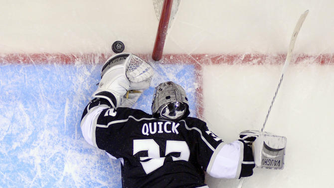 Los Angeles Kings goalie Jonathan Quick reaches for the puck aftar being scored on by Anaheim Ducks right wing Teemu Selanne, of Finland, during the third period in Game 3 of an NHL hockey second-round Stanley Cup playoff series, Thursday, May 8, 2014, in Los Angeles. The Ducks won 3-2