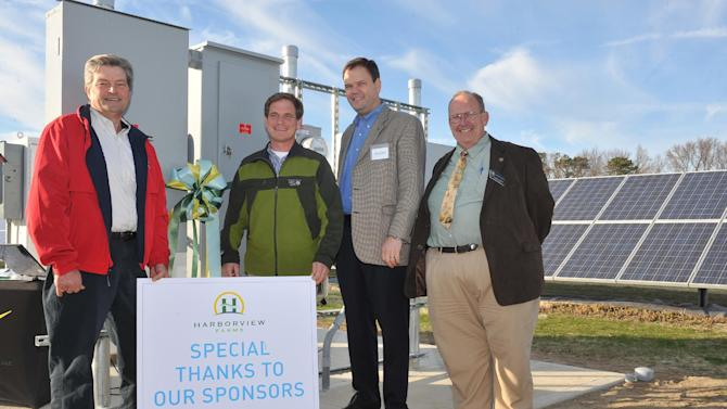 "IMAGE DISTRIBUTED FOR DUPONT - Left to right, Earl ""Buddy"" Hance, Maryland Secretary of Agriculture; Trey Hill, Partner, Harborview Farms; John Chrosniak, Director, North America DuPont Crop Protection and Richard Sossi, liaison for Maryland Congressman Andy Harris prepare to activate a new 200 kW solar array at the Sustainable Agriculture Celebration at Harborview Farms on Thursday, Dec.. 6, 2012 in Rock Hall, MD. Harborview Farms is one of the largest and most sustainably driven farming operations in Maryland. (Larry French/AP Images for DuPont)"