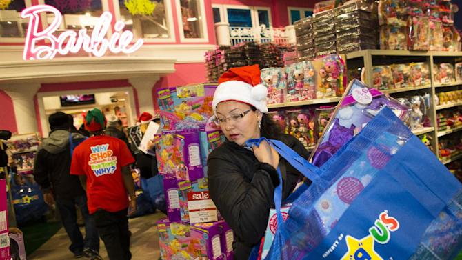 A shopper browses the aisles at the Times Square Toys-R-Us store after doors were opened to the public at 8 p.m. on Thursday, Nov. 22, 2012, in New York. While stores typically open in the wee hours of the morning on the day after Thanksgiving known as Black Friday, openings have crept earlier and earlier over the past few years. Now, stores from Wal-Mart to Toys R Us are opening their doors on Thanksgiving evening, hoping Americans will be willing to shop soon after they finish their pumpkin pie. (AP Photo/John Minchillo)