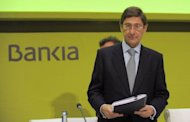 <p>President of Bankia Jose Ignacio Goirigolzarri stands during a Bankia shareholders' meeting. Furious pensioners who lost savings through investments in Bankia booed its managers Friday, branding them thieves, at the first shareholders' meeting since the bank's huge rescue.</p>