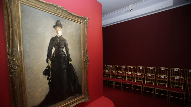 """The painting by Eduard Manet, The Parisian, (1875), hangs on the mirrored catwalk during the press day of the Impressionism Fashion exhibition in at the Orsay museum in Paris, Friday, Sept. 21, 2012. To coincide with Paris Fashion week, a new and highly original exhibit  called """"Impressionism and Fashion"""" opens at the Musee d'Orsay. It uses famous works of art to explore how at the dawn of impressionism, and as an emblem of """"modernite""""  fashion, and how people dressed, became one of the main themes in art. The exhibition will open September 25, 2012 and last till January 2013. (AP Photo/Michel Euler)"""