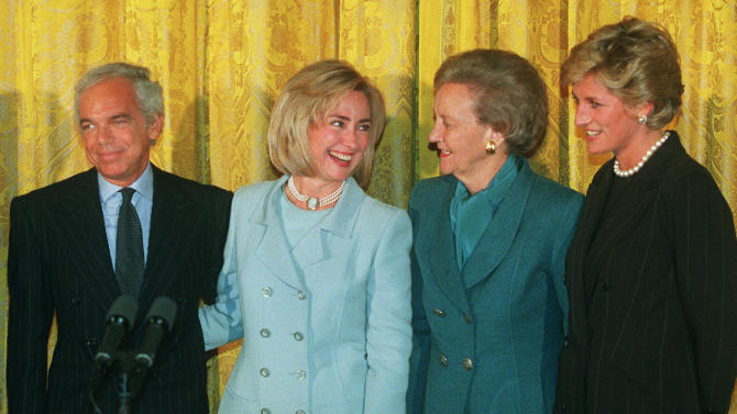 FILE - In this Sept. 24, 1996 file photo, First lady Hillary Rodham Clinton, second from left, hosts, from left, designer Ralph Lauren, Katharine Graham, chairman of the board, The Washington Post Company, and Princess Diana during a breakfast at the White House in recognition of the Nina Hyde Center for Breast Cancer Research. (AP Photo/Wilfredo Lee, File)