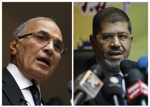 FILE - COMBO - This combination of two photos shows Egyptian presidential candidates, from left, Ahmed Shafiq, and Mohammed Morsi. The chairman of Egypt's presidential election commission says the Muslim Brotherhood's candidate and Hosni Mubarak's last prime minister will context next month's runoff vote. Farouq Sultan said Monday the official final results show the Brotherhood's Mohammed Morsi and Ahmed Shafiq, a former air force commander, as the top two finishers in the first round of voting on May 23-24. He said Morsi won 5.76 million votes, while Shafiq garnered 5.5 million votes.(AP Photo/Khalil Hamra; Nasser Nasser, File)
