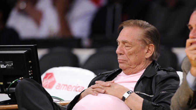 Los Angeles Clippers owner Donald Sterling closes his eyes as he watches the Clippers play the Utah Jazz during the second half of a preseason NBA basketball game, Saturday, Oct. 16, 2010, in Los Angeles. (AP Photo/Mark J. Terrill)