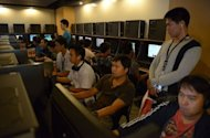 Customers at an Internet cafe in Manila look at Facebook profiles that have turned black as part of a protest against a cybercrime bill that took effect on October 3. Philippine President Benigno Aquino has defended a new cybercrime law amid a storm of protests from critics who say it will severely curb Internet freedoms and intimidate netizens into self-censorship