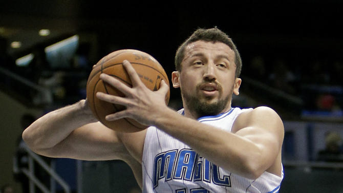 In this Feb. 10, 2012, photo, Orlando Magic's Hedo Turkoglu grabs a rebound against the Atlanta Hawks during an NBA basketball game in Orlando, Fla. Turkoglu was suspended 20 games by the NBA on Wednesday, Feb. 13, 2013, after testing positive for steroids. The NBA said Turkoglu tested positive for methenolone, an anabolic steroid. He will begin serving the suspension Wednesday night in Orlando's game against the Atlanta Hawks. (AP Photo/John Raoux)