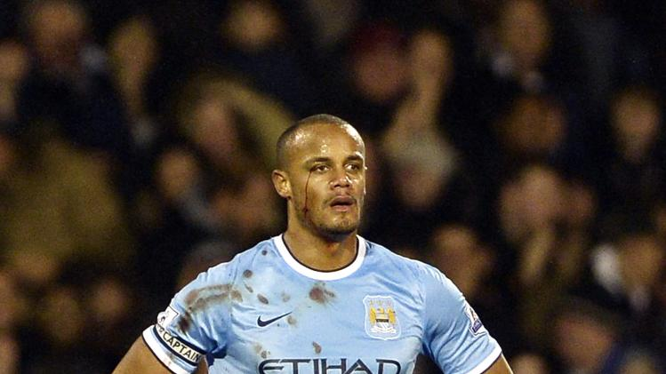 Manchester City's Vincent Kompany reacts after scoring an own goal for Fulham during their English Premier League soccer match in London