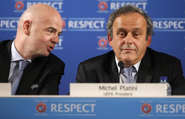 UEFA President Michel Platini, right, and UEFA General Secretary Gianni Infantino hold a press conference one day prior to the UEFA EURO 2016 qualifying draw at the Acropolis Convention Centre in Nice