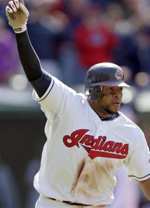 Santana has hit in 11th, leads Indians to win