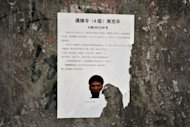 A wanted poster of Zhou Kehua, a fugitive armed robber and suspected serial killer, dubbed China's most dangerous man, on the wall near where he was shot dead in the southwestern megacity of Chongqing