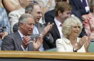 Britain&#39;s Prince Charles, left, and his wife Camilla, Duchess of Cornwall, applaud in the Royal Box at the start of a second round men&#39;s singles between Roger Federer of Switzerland Fabio Fognini of Italy during a match at the All England Lawn Tennis Championships at Wimbledon, England, Wednesday, June 27, 2012. (AP Photo/Kirsty Wigglesworth)