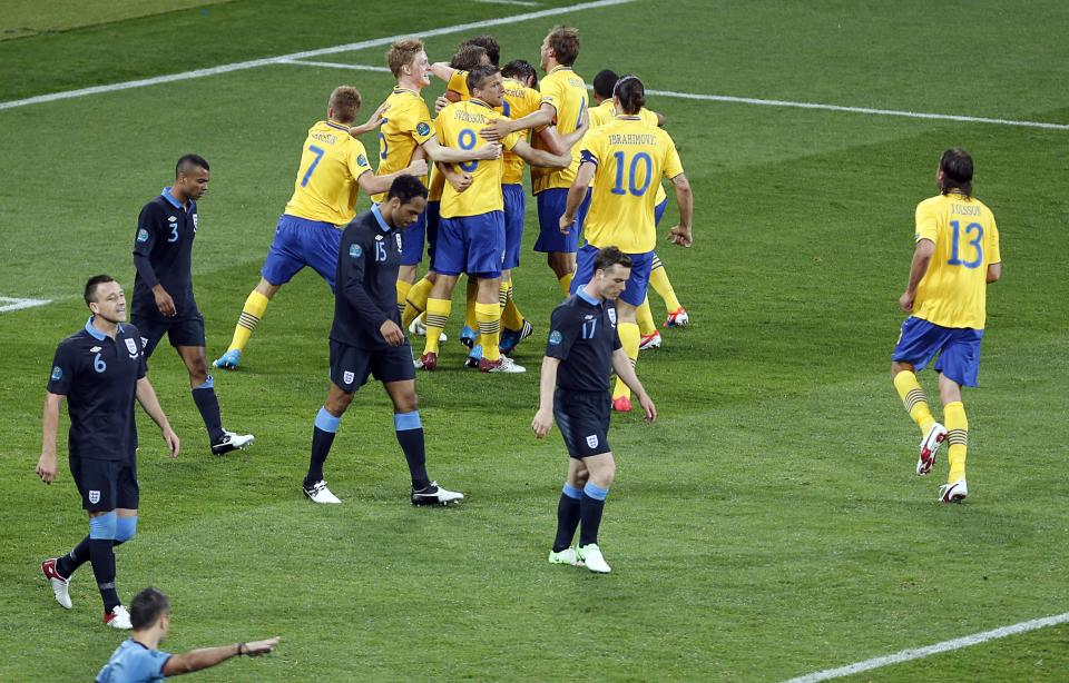England's John Terry, Ashley Cole,  Joleon Lescott and England's Scott Parker, from left, look disappointed after Sweden scored their first goal during the Euro 2012 soccer championship Group D match between Sweden and England in Kiev, Ukraine, Friday, June 15, 2012. (AP Photo/Darko Vojinovic)