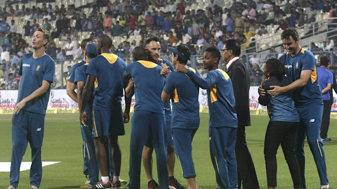 South Africa's captain du Plessis celebrates with his teammates after the third and final Twenty20 cricket match against India was abandoned in Kolkata